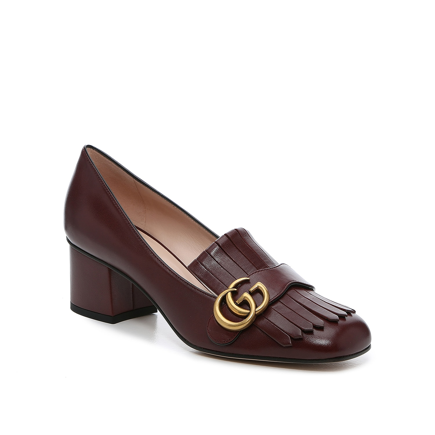 Elevating the appearance of a classic loafer, the Marmont 55 is a timeless Gucci design. Double G hardware with an antique gild decorates folded kiltie fringe that drapes over the vamp and draws attention to the modern yet softened square toe.   Made in Italy from carefully selected materials. To extend product life, protect from direct light, heat, and rain. Fill shoe with tissue paper to help maintain the shape and absorb humidity. Store in the provided flannel bag and structured shoe box.
