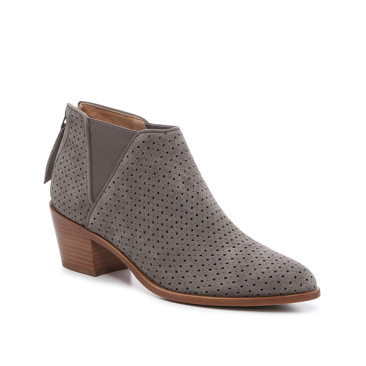 The Tisha shootie from Trask is a minimal ankle boot featuring a low-slung heel, Chelsea-style goring for a hint of stretch, and hand-stitched detailing along the midsole. A stacked Cuban heel adds interesting angles to these low-profile booties.Click here for Boot Measuring Guide.