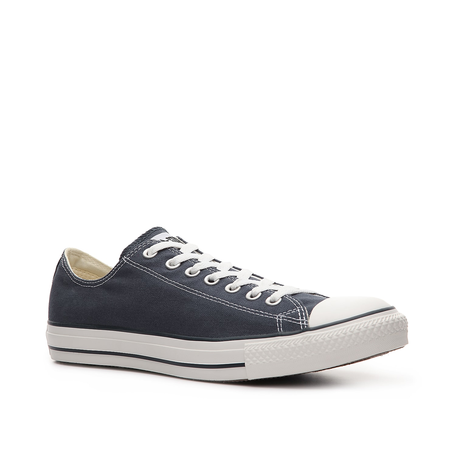 The nostalgic retro styling of the low-top classic navy blue Converse Chuck Taylor All Star sneaker will never go out of style. Incorporate the vintage shoe into your casual wardrobe and make it your own, footwear for men in timeless navy.